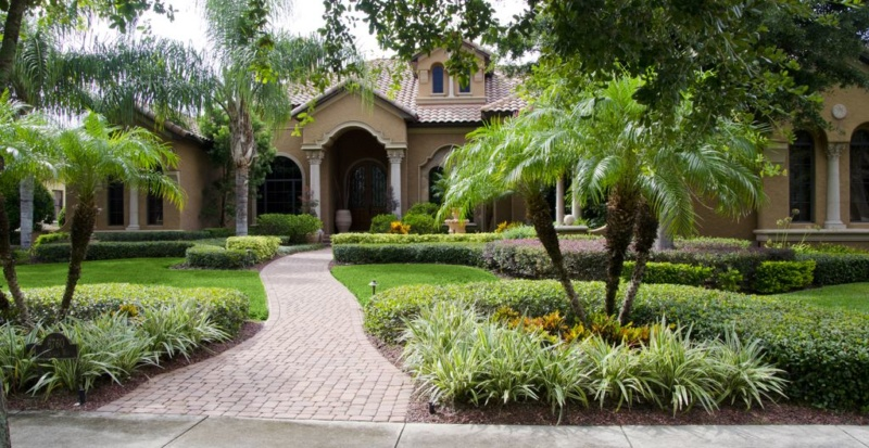 curb appeal home landscaped with grasses bushes trees flpalmbeach.com Martin Group Homes For Sale