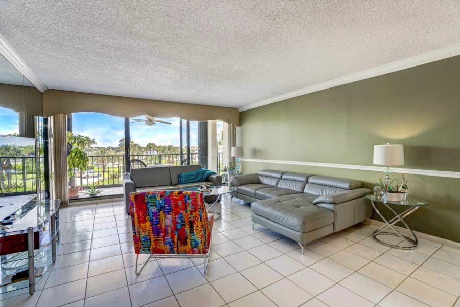 Old Port Cove Condo 1200x800 Living Room Balcony FLPalmBeach Martin Group Real Estate 1200x800