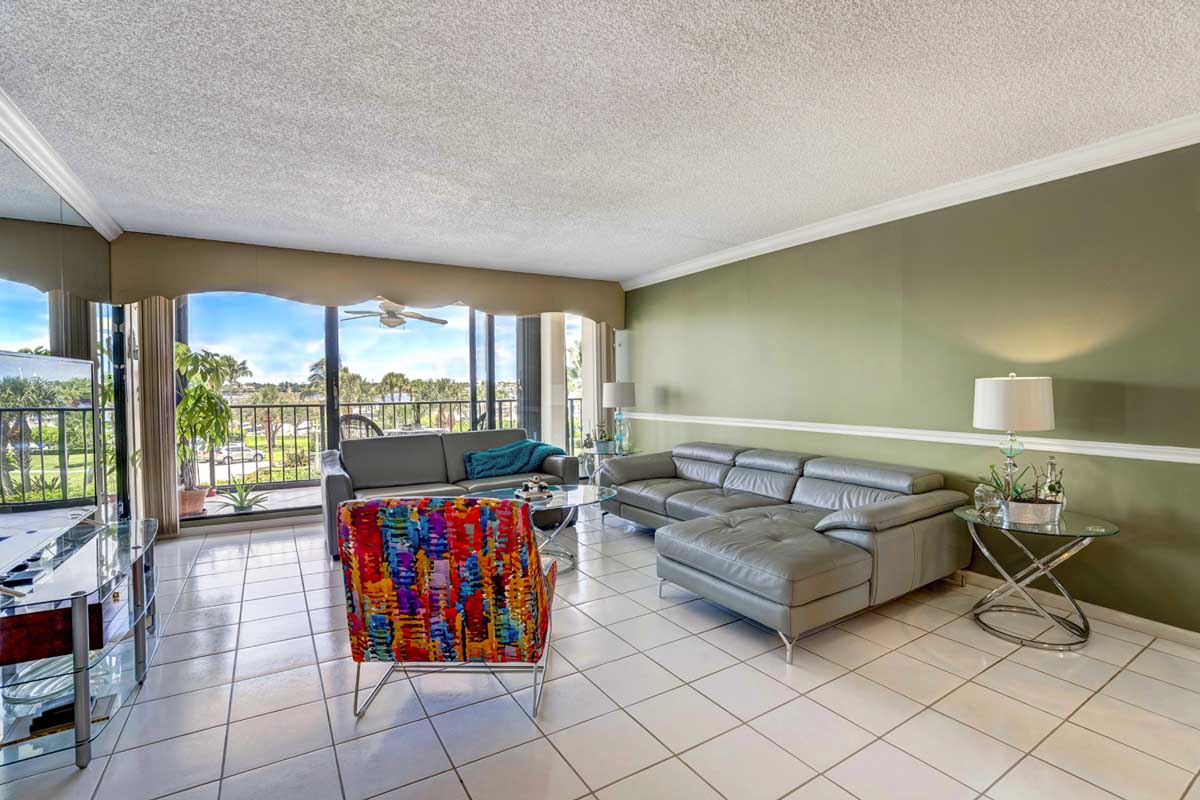 Old Port Cove Condo Living Room Balcony FLPalmBeach Martin Group Real Estate Image2 Image