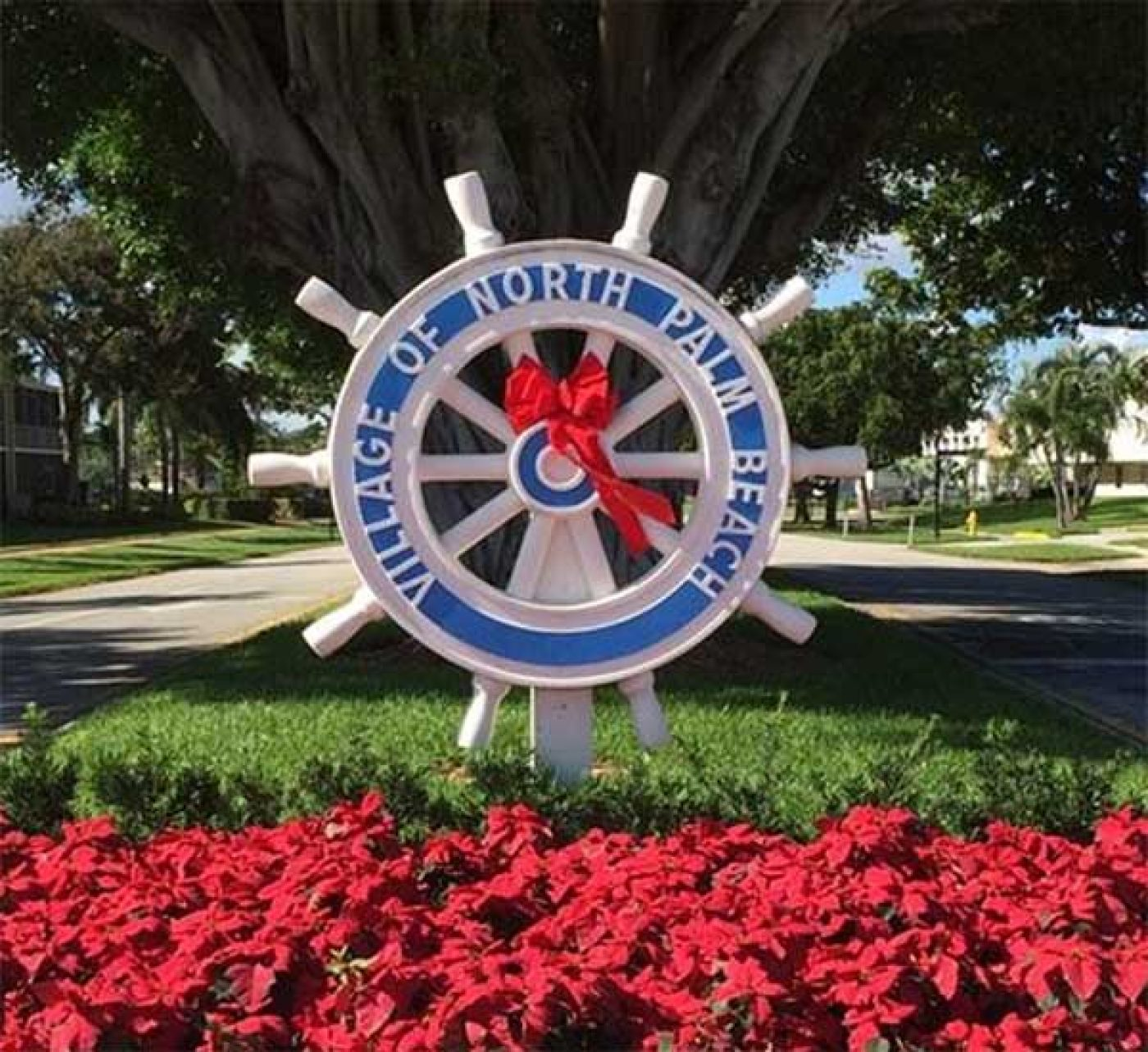 North Palm Beach Village Logo FLowers FLPalmBeach Martin Group Real Estate Image